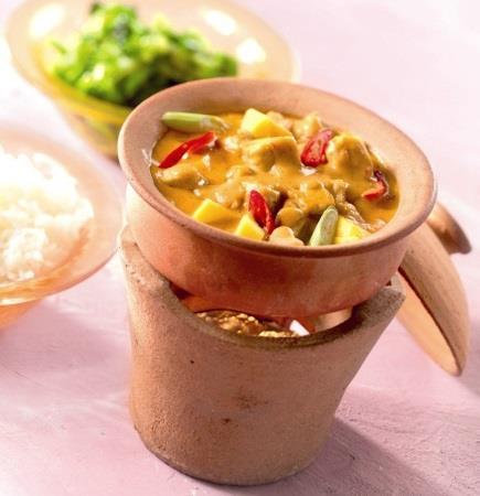 Thaigryta med röd curry och mango